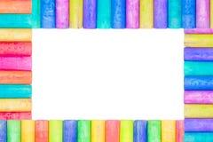 Row of rainbow chalk isolate on white background. Row of rainbow colored chalk isolate on white background Stock Image