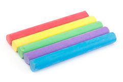Row of rainbow color chalk on white Royalty Free Stock Photos