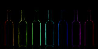 Row of rainbow colored bottles Stock Images