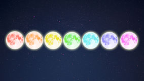 Row of rainbow colored full moons on starry sky background Stock Image