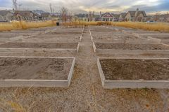 Row of raised beds against homes and sky in Utah stock photos