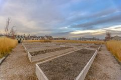 Row of raised beds amid grasses and homes in Utah royalty free stock photo