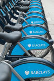 Row of rear wheels of cycles in london Stock Photography