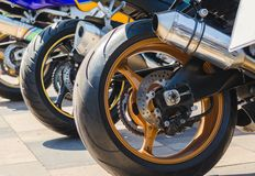 Row of rear wheels of sports bikes in competition. Close up stock image