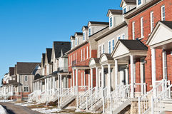 Row of Recently Built Townhouses. A row of recently built townhouses on a suburban street in winter Royalty Free Stock Photography