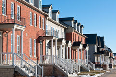 Row of Recently Built Townhouses in the Suburbs. A row of recently built townhouses on a suburban street in winter Royalty Free Stock Photos