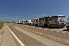 Row of recreational vehicles parked on road Royalty Free Stock Image