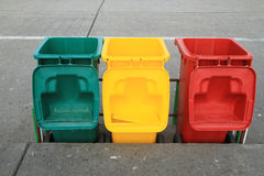 Row of recycle bins. On cement floor Stock Image