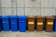 Row of Recycling and Garbage Cans Stock Images