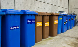 Row of Recycling and Garbage Cans Royalty Free Stock Image