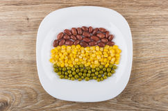Row of red beans, green peas and sweet corn Stock Images