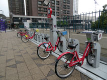 Row of red bicycles at Bike Share station on a rainy day Royalty Free Stock Photography