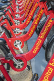 Row of Red Bicycles Used in the Capital Bikeshare Program Resting on the sidewalk #1 Stock Photos