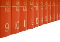 Row of Red Books. Red Books against white. Shallow depth of field. Focused on 12 Royalty Free Stock Images