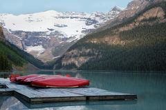Row of canoes, Banff National Park Royalty Free Stock Photo