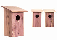 Row of bird houses over white Royalty Free Stock Photography
