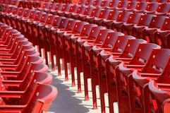 Row of red chairs rounded Stock Images