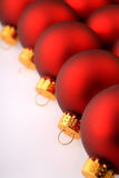 Row of Red Christmas Ornaments. A diagonal row of Red Christmas Ornaments Stock Images