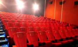 Row of red cinema seat from side angle view Stock Photography