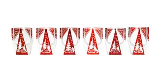Row of red crystal liqueur glasses with Stock Images