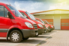 Row of red delivery and service cars Stock Photo