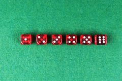 A row of red dices from one to six. On green background stock images