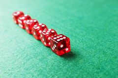 A row of red dices from one to six. On green background stock image