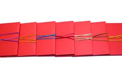 Row of red envelopes with ribbons Stock Photo