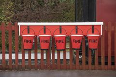 A row of red fire buckets Royalty Free Stock Photos