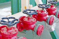 Row of red fire hydrants Stock Photography