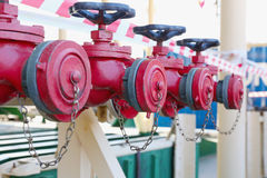 Row of red fire hydrants Stock Photos