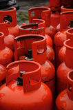 Row of red gas canisters. Rows of multiple red gas containers Royalty Free Stock Photos