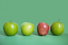 Row of red and green apples over colored background Stock Image