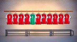 Row of Red and Green Football shirts Shirts 3-5 Royalty Free Stock Photos