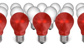 Row of red light bulbs in front of white ones Royalty Free Stock Photos
