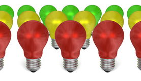 Row of red light bulbs in front of yellow and green ones Stock Image