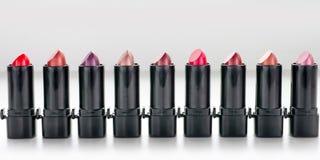 Row of red lipsticks stock image