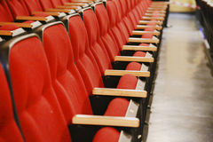 Row of red movie theatre seats Stock Photos