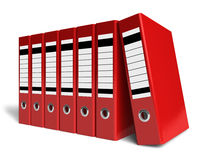 Row of red office folders. Isolated on white background Royalty Free Stock Photos