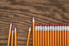 A row of red pencils on wood surface. A row of red pencils on wooden surface royalty free stock photography