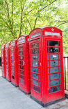 Row of red phone booth in London Stock Photography