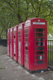 A row of red phone booths in London Royalty Free Stock Images