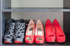 Row of red shoes in shelf Stock Photo