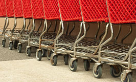 Row of red shopping carts Royalty Free Stock Photography