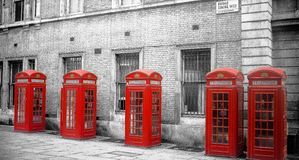 Row of red telephone boxes in London royalty free stock photo