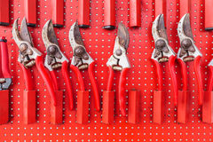 Row of red used garden shears Royalty Free Stock Image