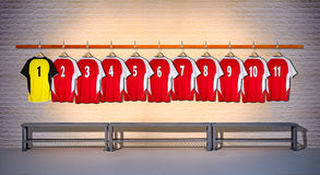 Row of Red and Yellow Football shirts Shirts 1-11 Royalty Free Stock Photo