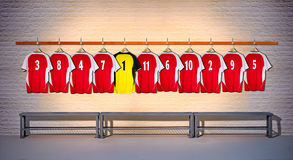 Row of Red and Yellow Football shirts Shirts 3-5 Stock Image
