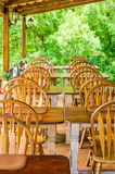 Row of retro wooden tables and chairs Stock Photography