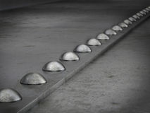 Row of rivets on the metal grunge background Royalty Free Stock Photos